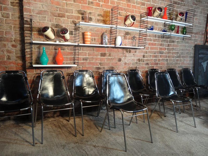 A large set of 12 black leather Charlotte Perriand Chairs For Les Arcs 1960