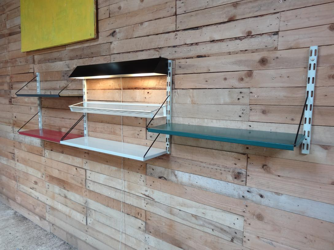 1960 Pilastro Tomado three section wall unit with Light, four shelves and Magazine rack designed by Tjerk Reijenga for Tomado Holland (price on request).
