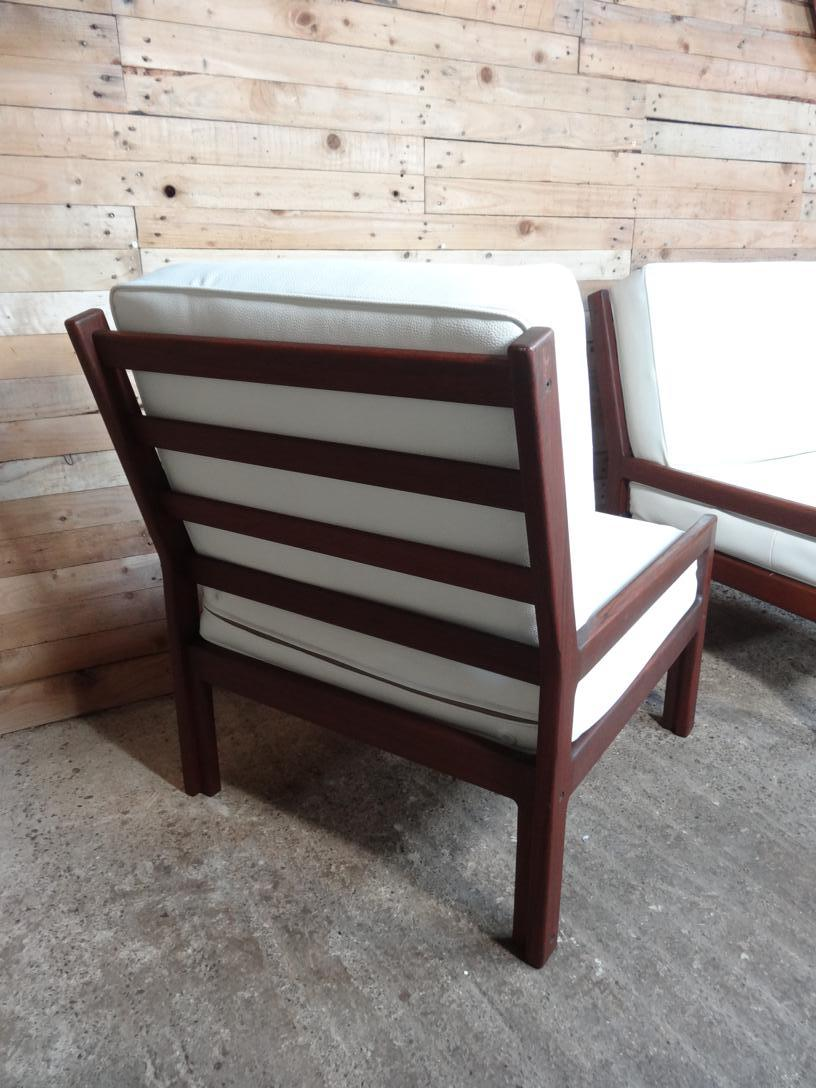 Teak arm chair with new leather seating cushions (price on request)
