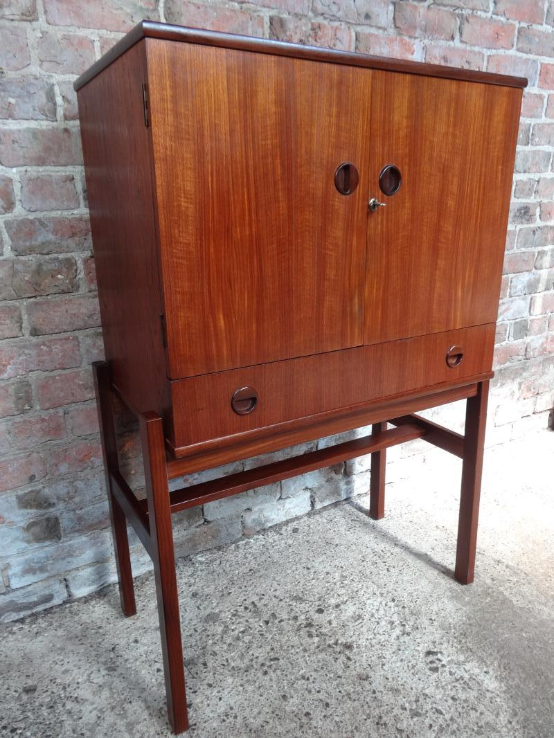 Stylish retro Vintage 1960 Teak Cocktail cabinet with mirror and glass shelf + light