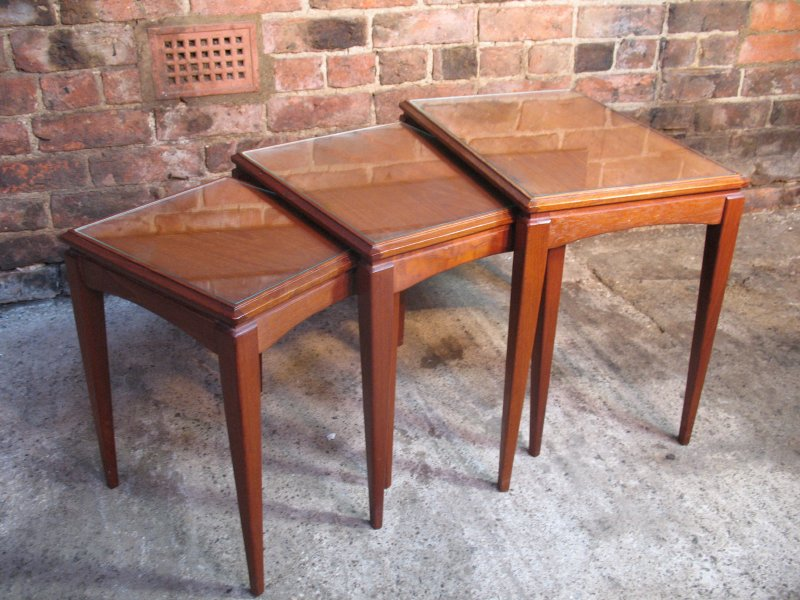 Organic teak nest of tables (3) with glass protection top