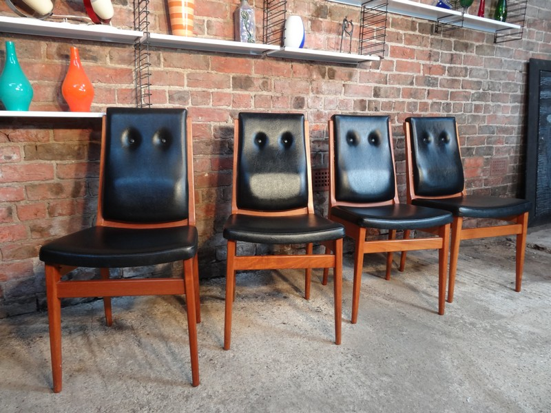 4 Solid teak / vinyl arm Chairs