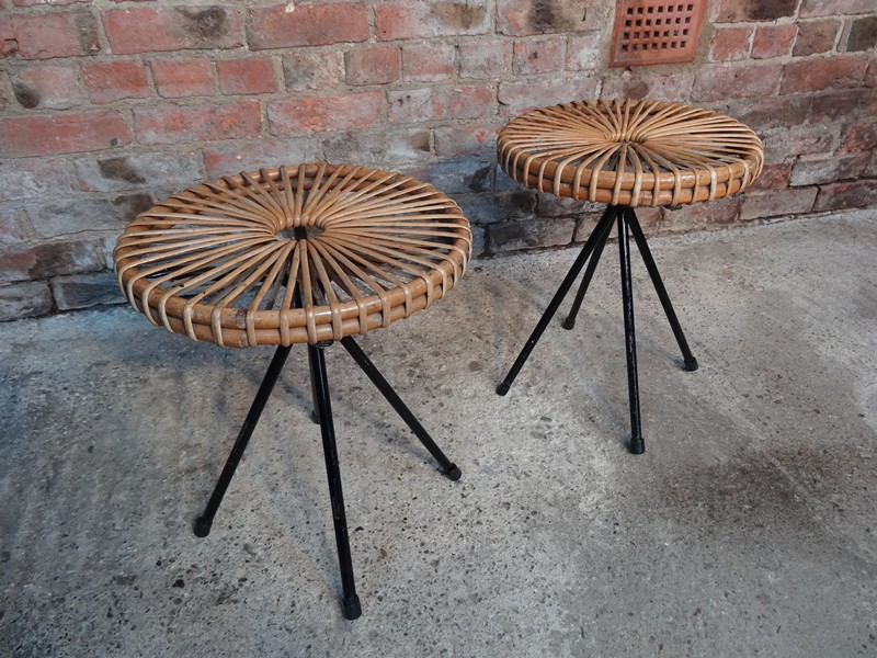 **sold** Two 1950's cane stools on metal rod legs