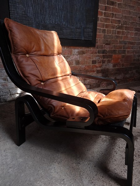 **SOLD**1970's Danish black wood brown leather arm chair