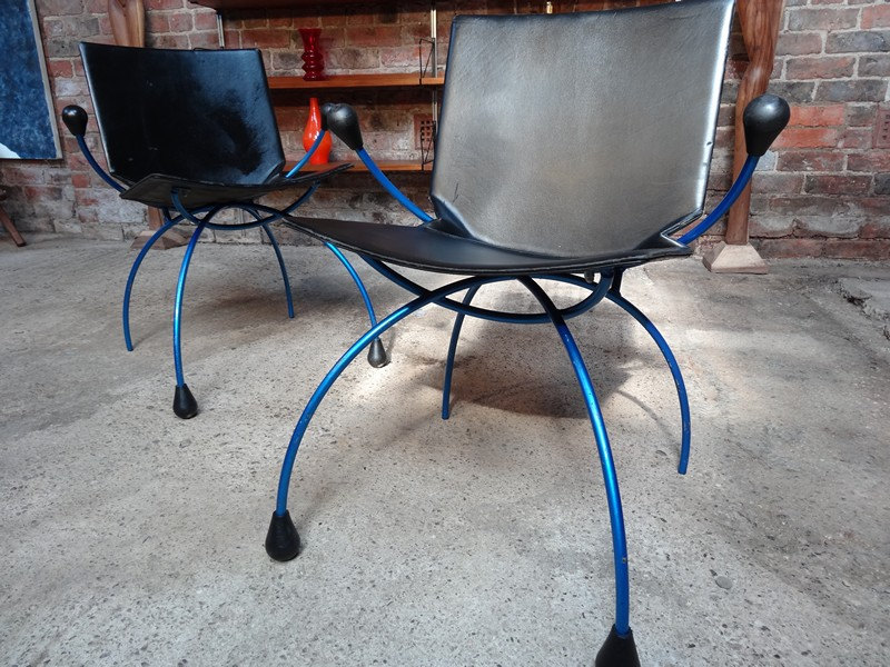 two blue metal framed 'spider' chairs (price on request)