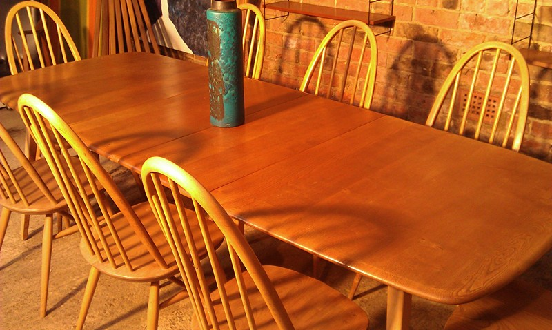 Large Ercol extendable 5 legged table with 10 chairs