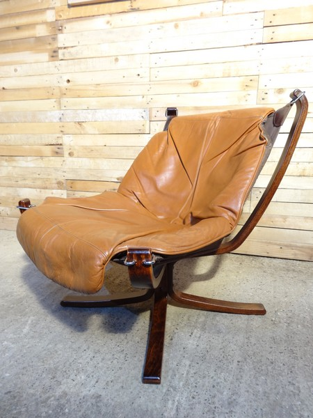Light brown leather Falcon chair designed by Sigurd Resell