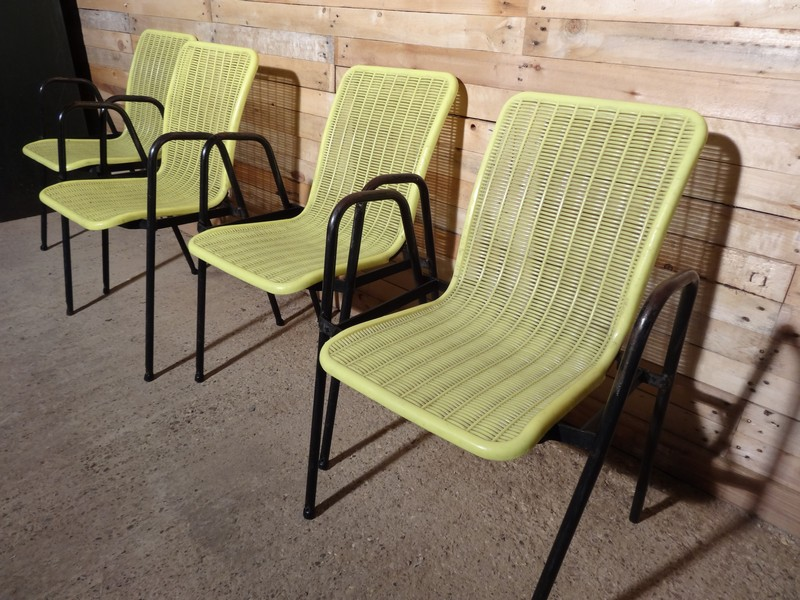 Pair of French yellow plastic chairs