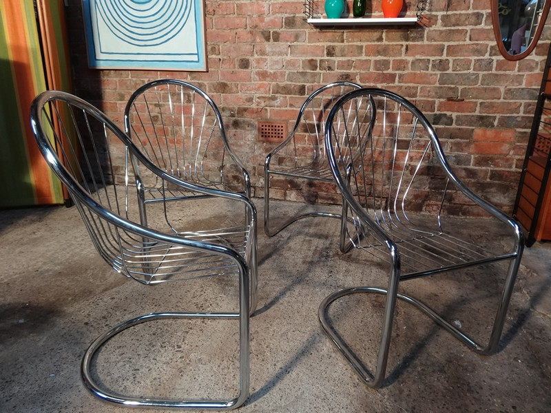 A set of four tubular chrome and wire cantilever chairs