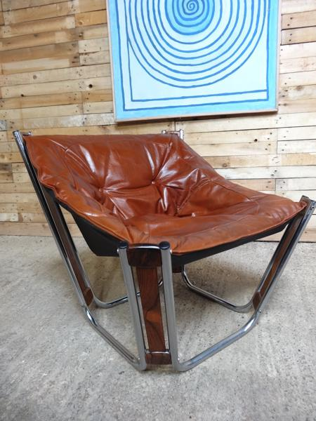 Brown leather chrome / rosewood slingback Relling armchair (price on request)