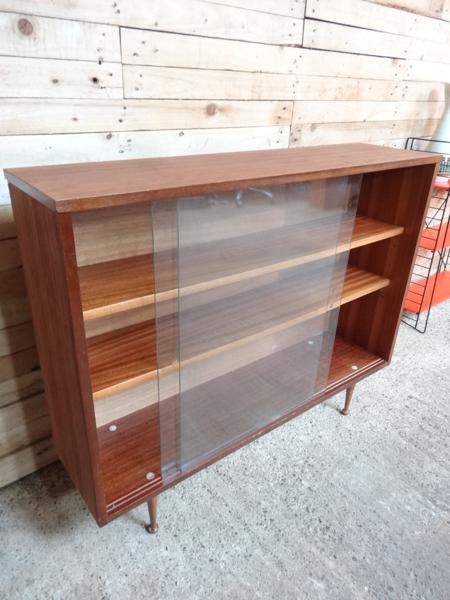 SOLD - 1950's cabinet on legs with glass front