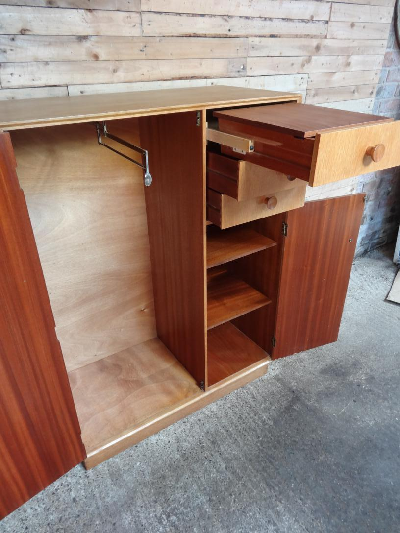 1950's oak cupboard with chest of drawers with mirror, hanging space and shelving