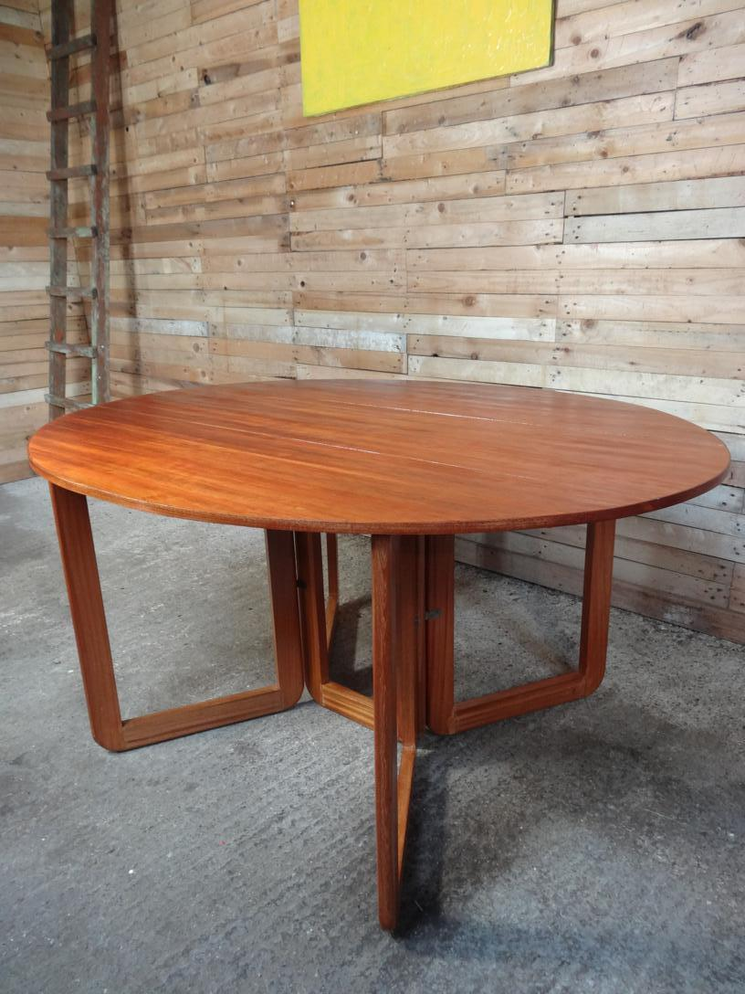 SOLD - Danish extendable dropdown teak table on U legs