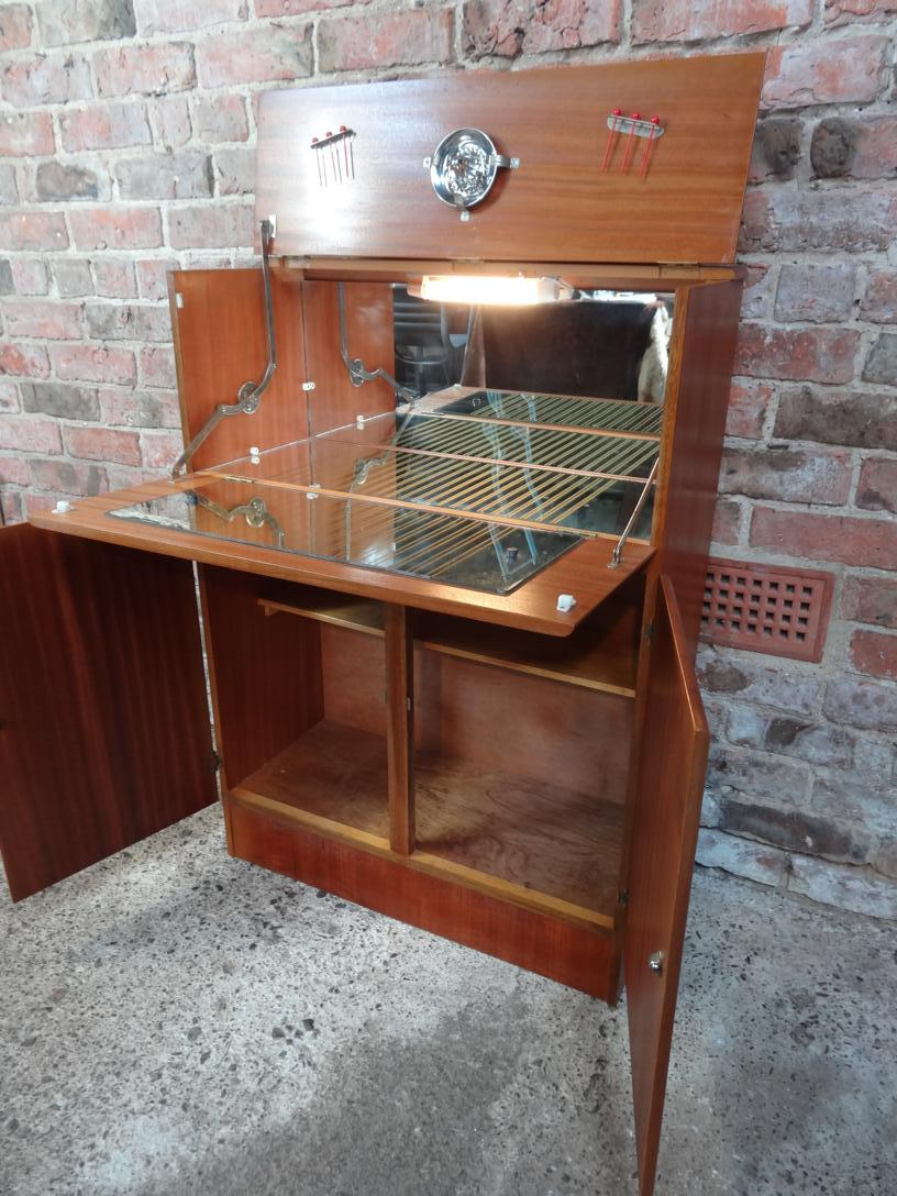 Stylish retro Vintage 1960 Cocktail cabinet with mirror and glass shelf + light