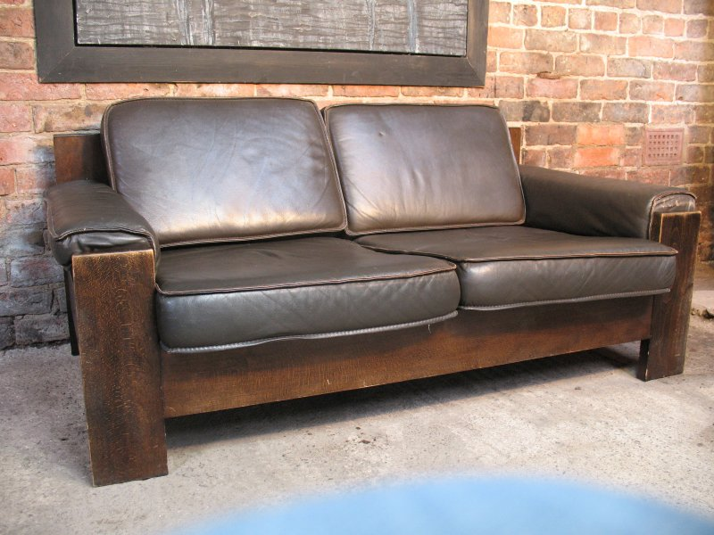 *sold*Vintage Leolux black / dark brown leather two seater sofa