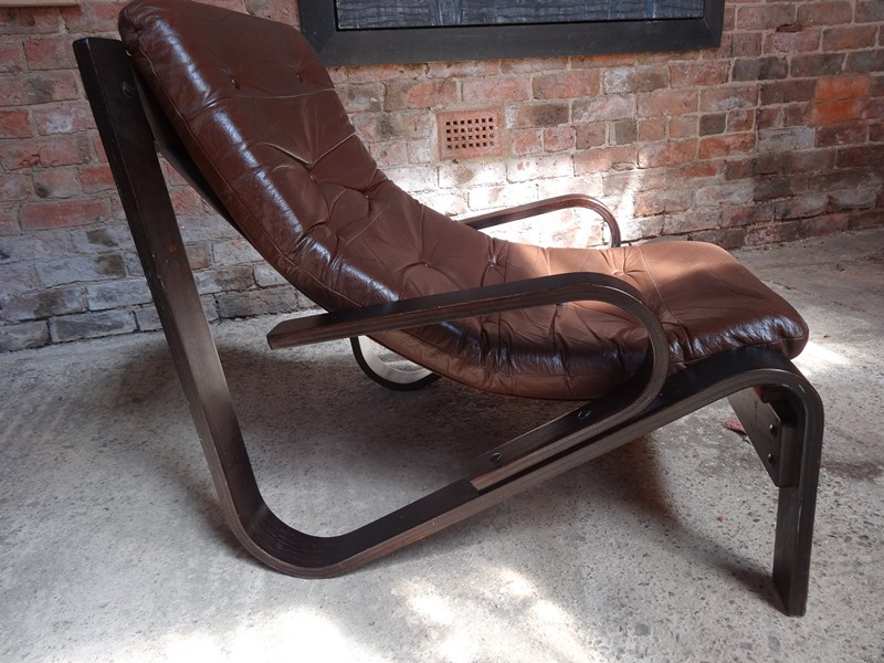 **SOLD**1970's Danish black wood dark brown leather arm chair